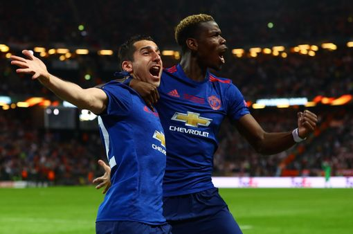 Henrikh Mkhitaryan celebrates his goal with Paul Pogba